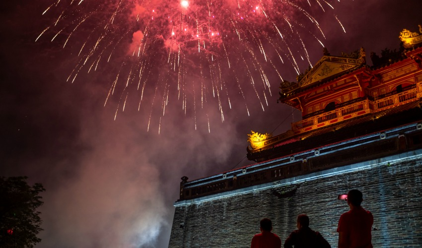 <who>Photo by Linh Pham/Getty Images</who>People watch the firework display in front of the Imperial City of Hue to mark the Lunar New Year or Tet celebrations on January 25, 2020 in Hue, Vietnam.
