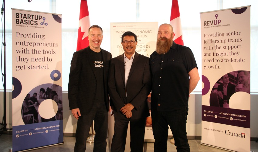 <who> Photo Credit: KelownaNow </who> Left to Right: Stephen Fuhr, MP for Kelowna-Lake Country; Raghwa Gopal, CEO of Accelerate Okanagan; Lincoln Smith, executive director of Kamloops Innovation.