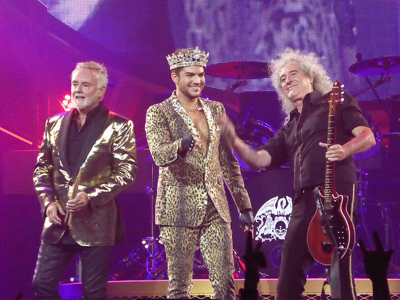 <who>Photo Credit: Wikipedia</who>Roger Taylor, Adam Lambert and Brian May.