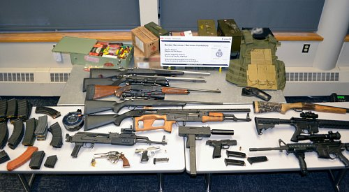 Alaskan charged with smuggling 14 guns into BC