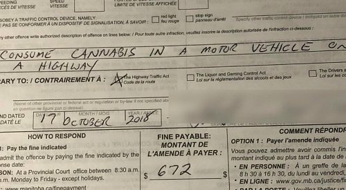 It didn't take long for a Canadian to be ticketed for smoking cannabis while driving